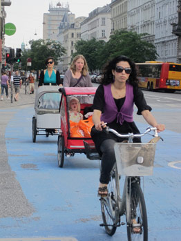 Moms and kids in bike transports