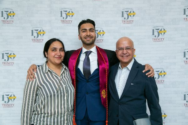 Graduate posing with family