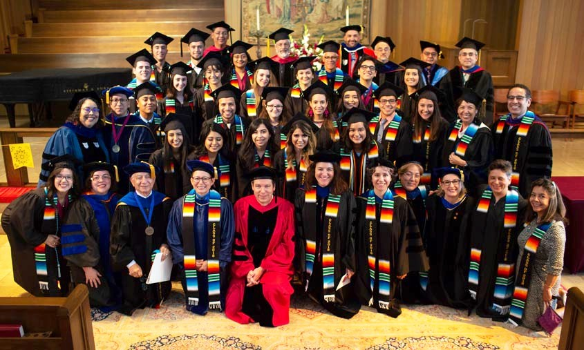 Students participating in De Colores ceremony