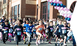 photo of participants running at the Step Sisters' Ribbon Run
