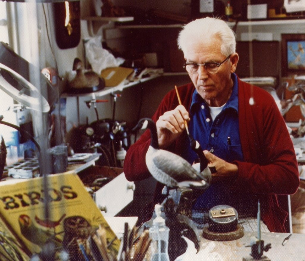 Wendell Gilley painting geese in his workshop