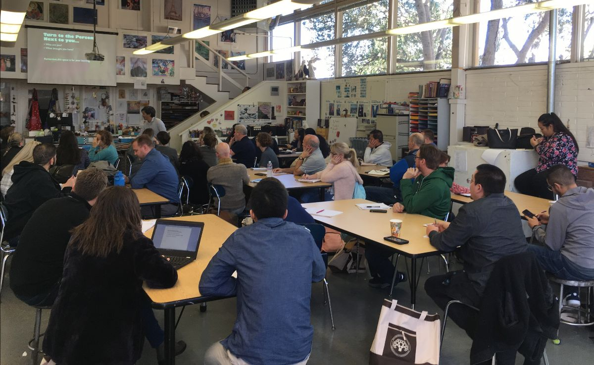 Nick Chan and full room of teachers