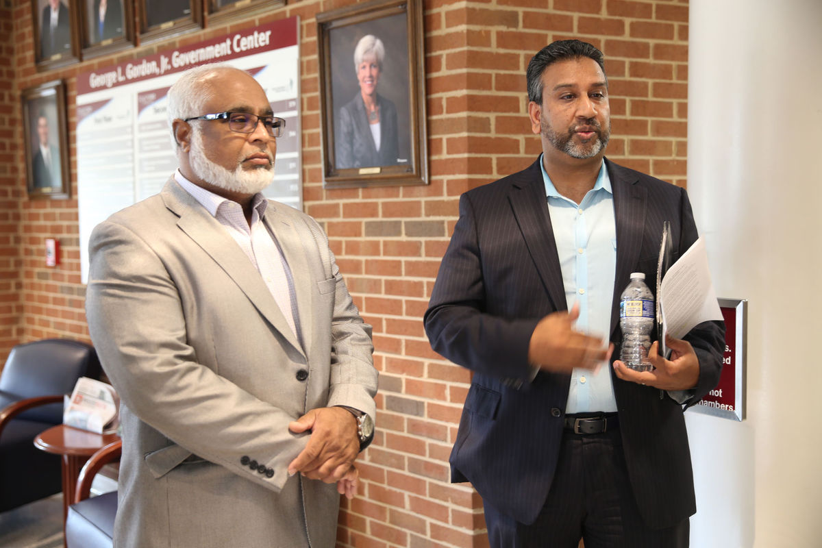 AMAA director Rafi Ahmed (left) and AMAA president Aftabjan 'John' Khan discuss cemetery regulations after a Stafford Board of Supervisors meeting on Sept. 19.