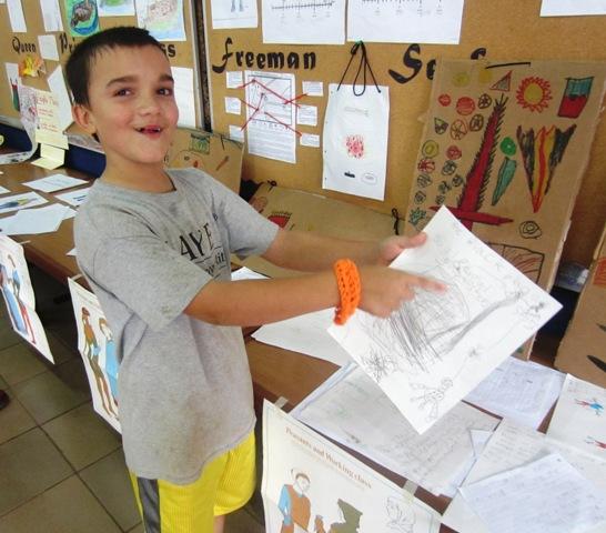 Jonah showing off his school work