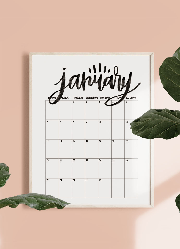 January calendar page in frame on pink wall