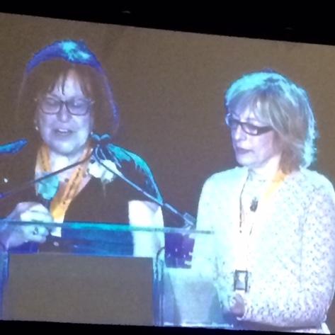 Paula Agulnik and Joanne Silkauskas and the podium, Celebration of People 2015