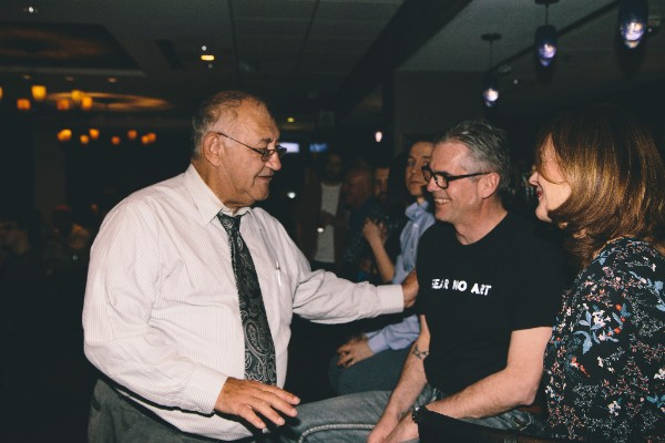 Reach Co-Founder Ernest Tannis with emcee David Yazbeck