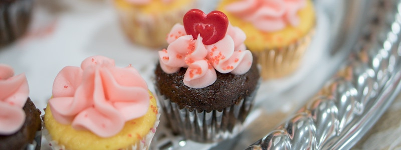 Cupcakes with pink icing and a sugar heart on top