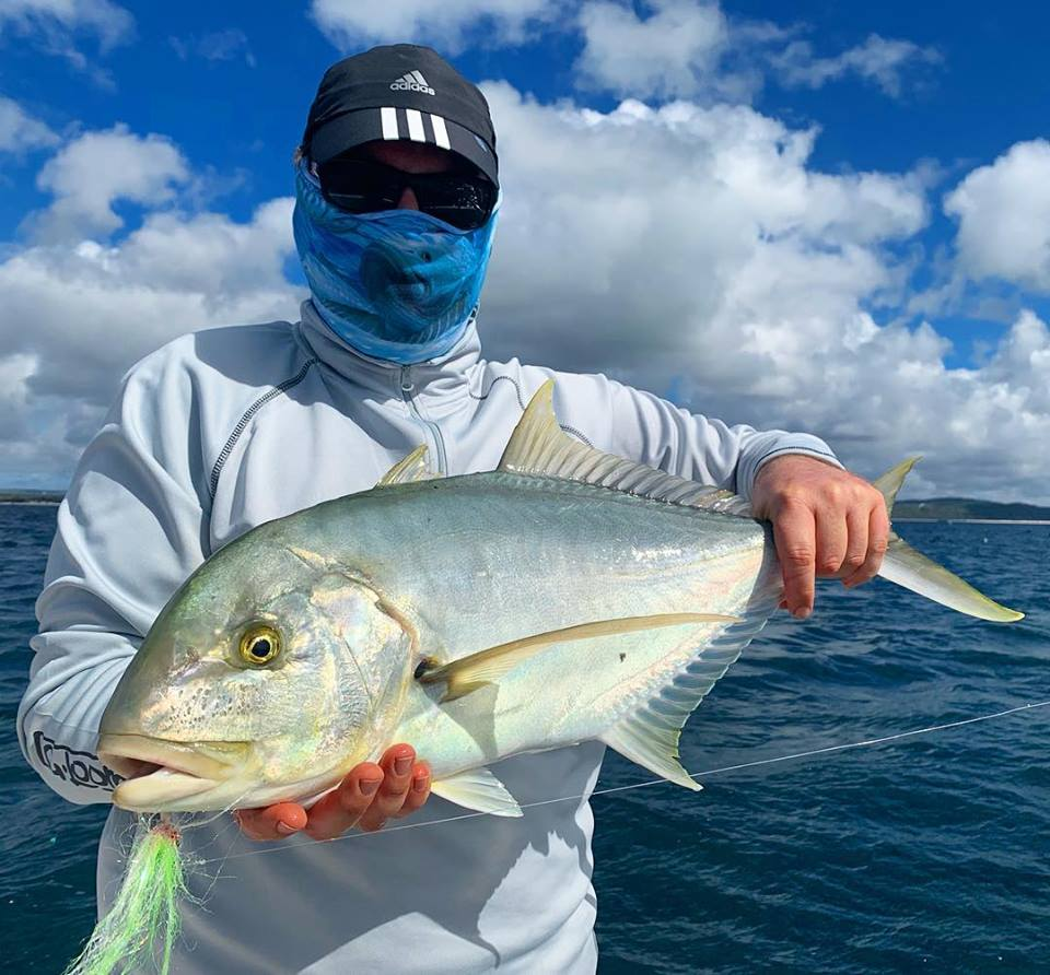 Paul with a Golden trevally caught off a bait ball on fly