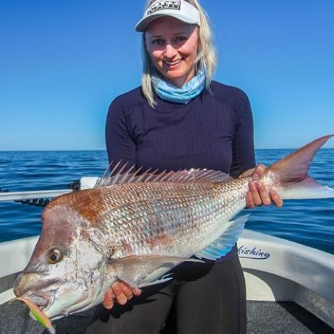 Liv with her PB snapper 83cm