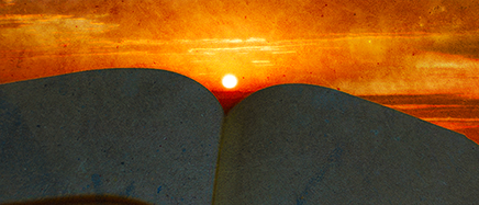 Sunset over an open book