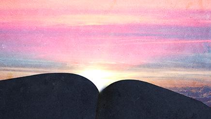 Sunrise over a book