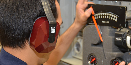 Man wearing hearing protection while working