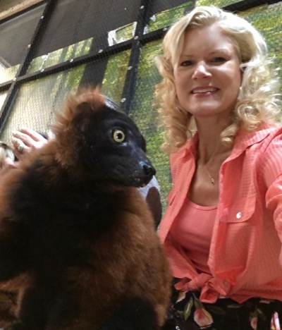 Rachelle Siegrist with Poseidon the Red Ruffed Lemur