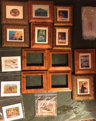 Siegrist miniature paintings being framed