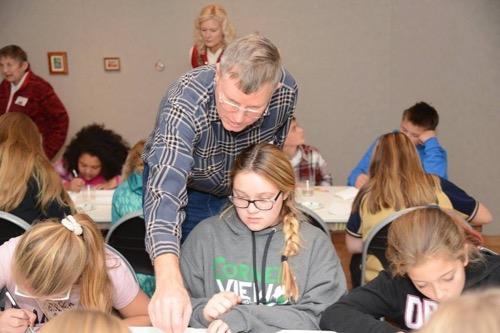 Wes teaching kids at LYWAM Residency