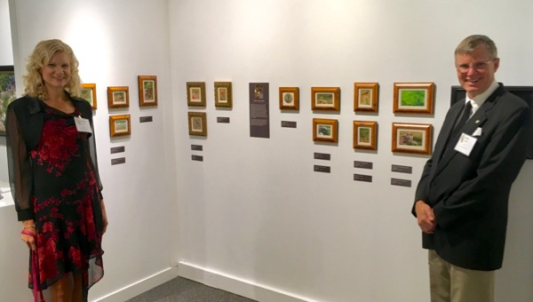 The Siegrists with their paintings at the Cincinnati Museum Center