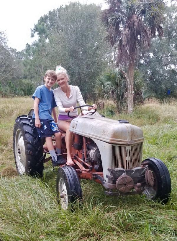 Rachelle Siegrist riding a tractor