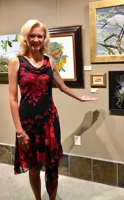 Rachelle Siegrist with her painting in the AWA Exhibition