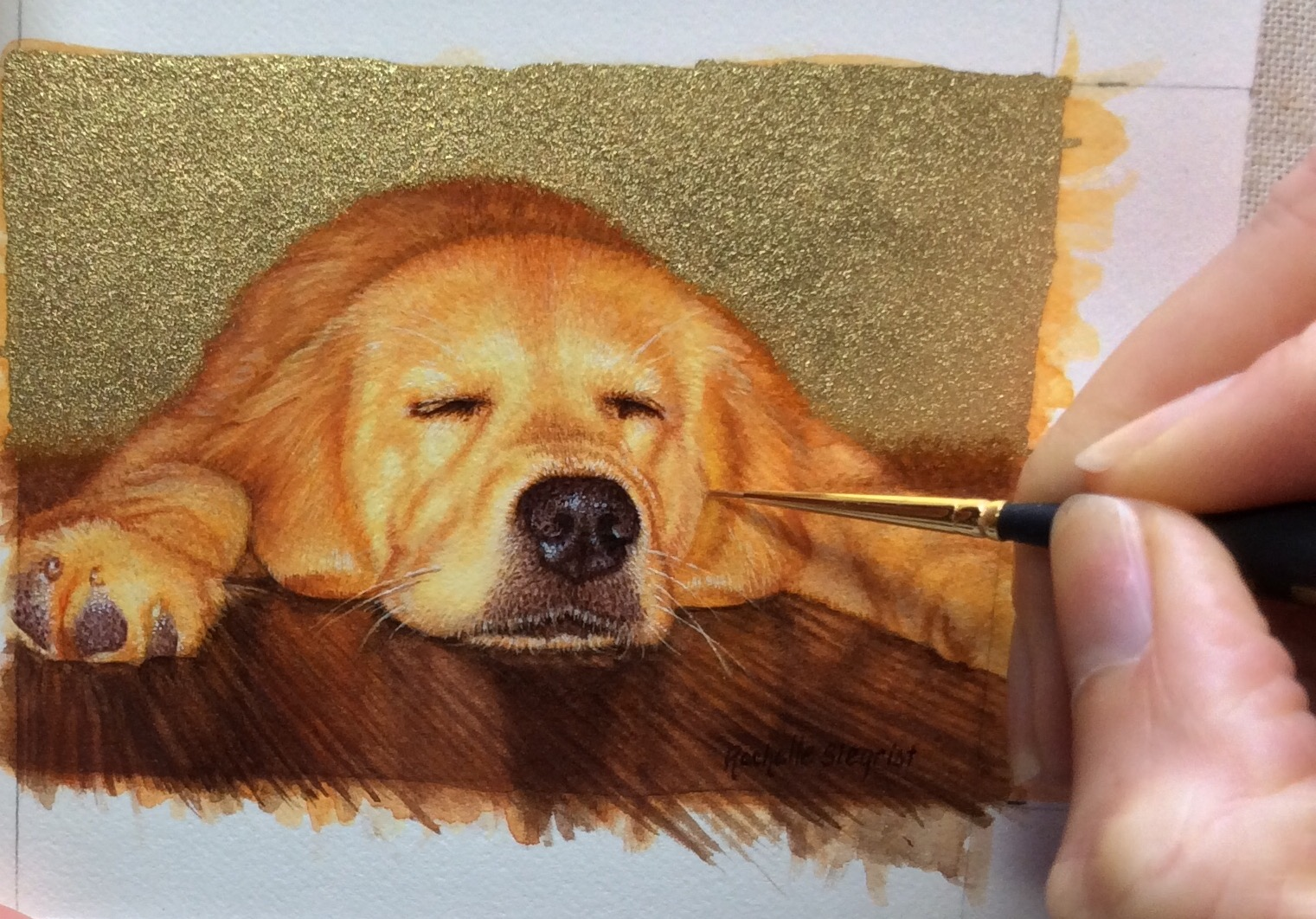Rachelle Siegrist working on a dog painting