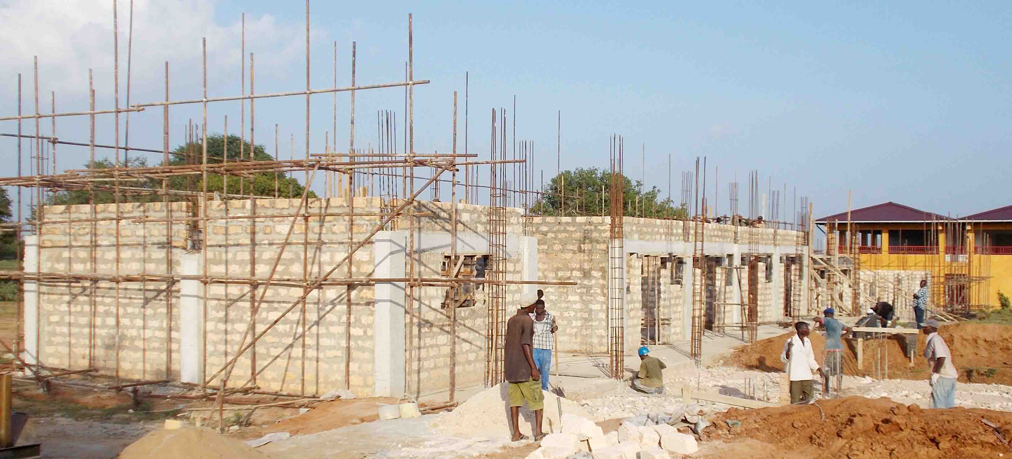 School Building under construction; Community Centre in the background