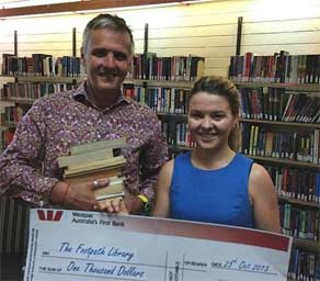 Board Director Shane McLachlan and Kylie Pearson, Davidson High School's Librarian, who was the driving force behind the students' fundraiser