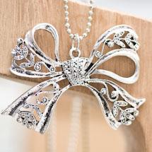 Pendentif Joli noeud papillon filigrane argent vieilli