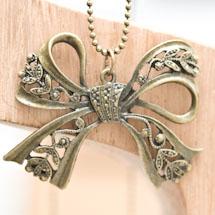 Pendentif Joli noeud papillon filigrane bronze vieilli