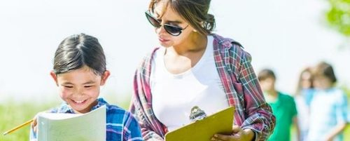 STEM Teaching Tools #62 Header Image. A teacher and student are holding clipboards outside.