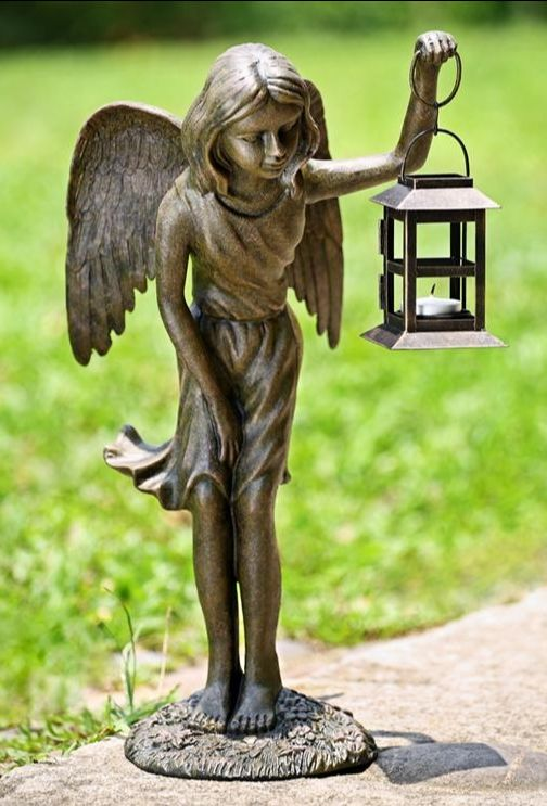 Angel with lantern statue