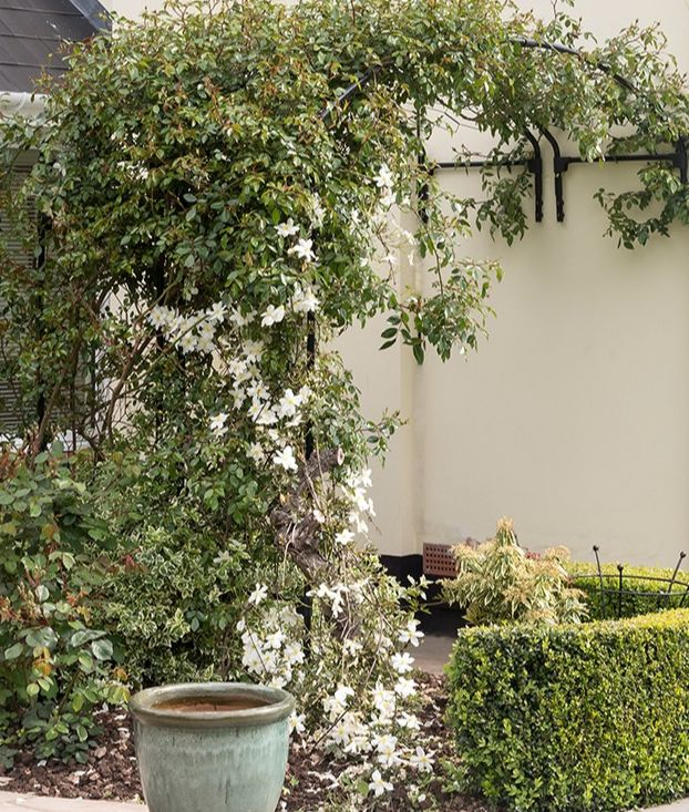 A wall arch can hide unsightly views.