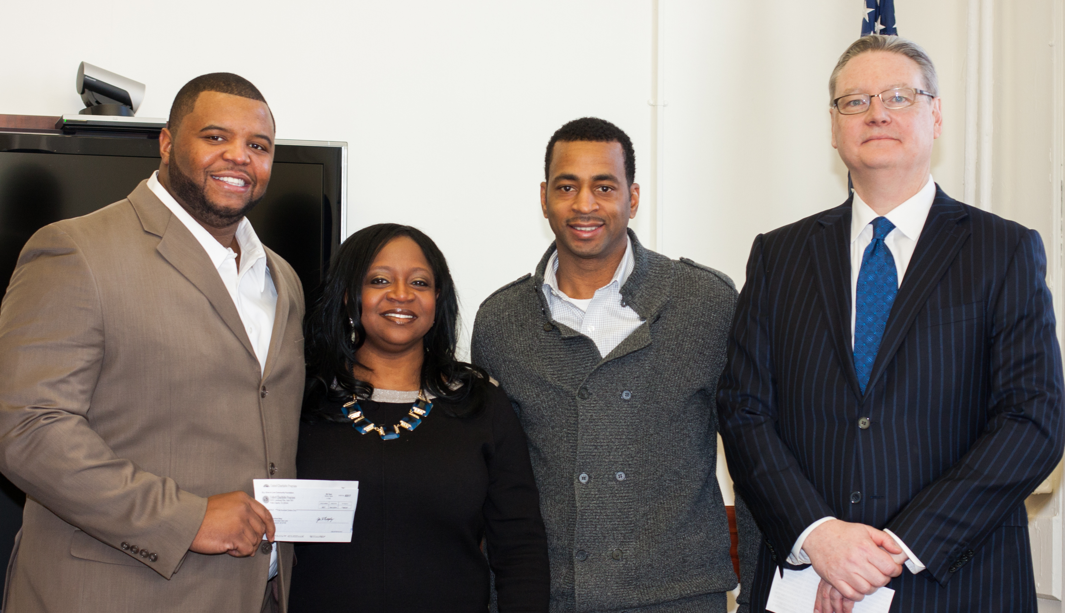 Feb 28 2014 LtoR NFL player Damien Gregory from GridIron Gang, JCFW Founder Desha Jackson, Director Ryan Strouther's from Jersey City Recreation, Kevin Cuskley.jpg