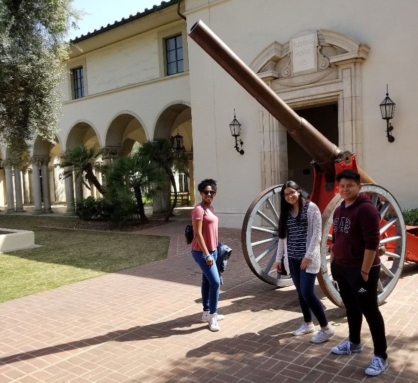 11th graders Zeñia, Maria, Teo pose at Caltech in front of the Fleming Cannon.