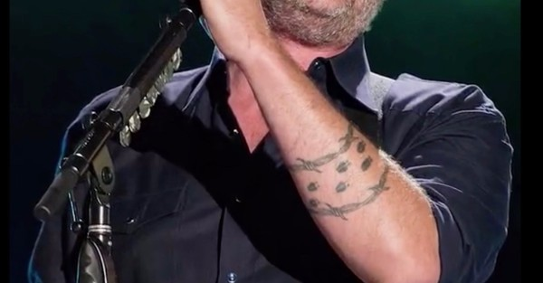 Blake Shelton's barbed wire tattoo on his left forearm