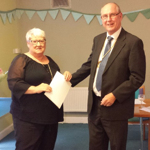 Volunteer Sue Dawn receiving her diploma