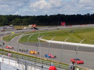 IndyCars racing past us