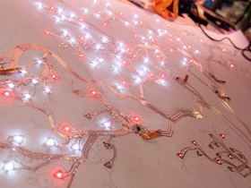 Paper circuits lit up on big sheet of paper