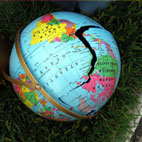 A plastic globe with a big crack in it