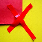 Red tape stuck to a yellow wall