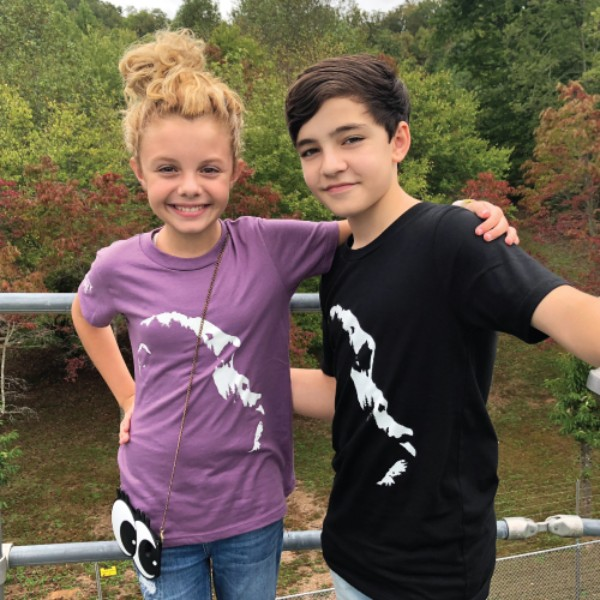 Actors Mallory James Mahoney and Bryce Gheisar wearing Project Chimps Tshirts