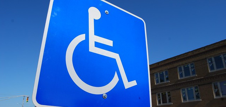 Accessible logo of person in a wheelchair as a street sign
