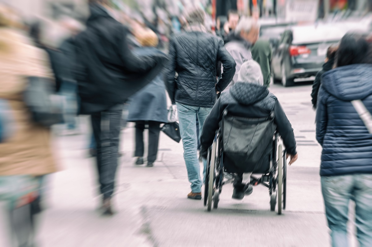 A person on a wheelchair photo taken from behind.