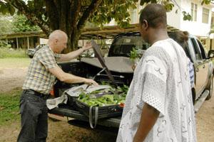 Garry unloading trees in Ghana, Africa