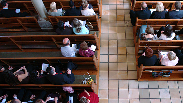 Photo of congregation sitting in pews. (Exkalibur/Getty Images)