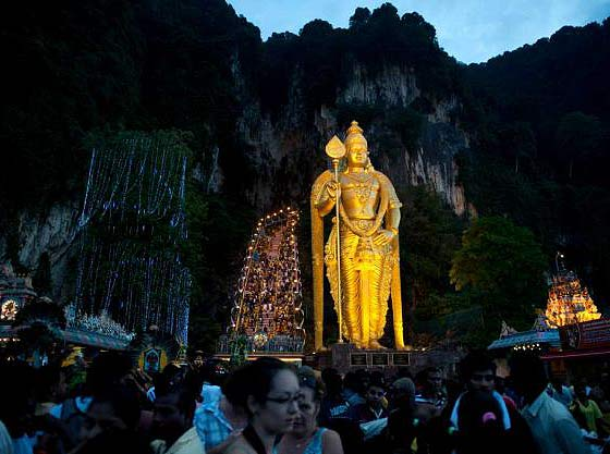 Hindu devotees make their way towards the Batu Caves to perform their religious rites before sunrise during the Thaipusam Festival on the outskirts of Kuala Lumpur on February 7, 2012.