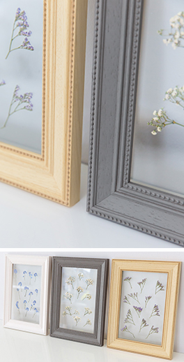 Dried flowers frame in the Virginia, ornate woodgrain mouldings