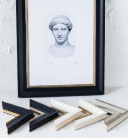 Classical bust framed in Aria moulding