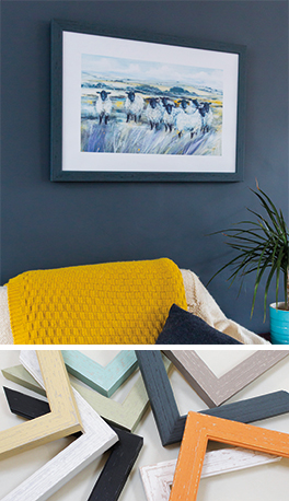 Sheep picture framed in Brighton Moulding hung on dark blue wall