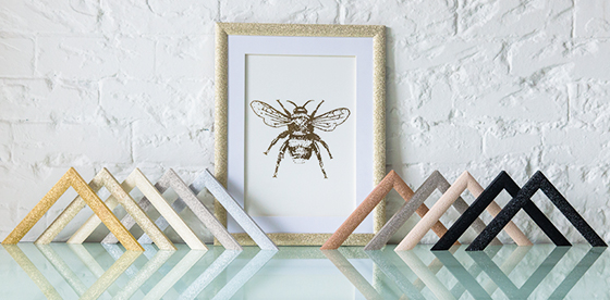 Large bee framed in Mainline's sparking Stardust range