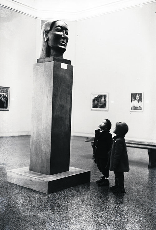Children viewing Ronald Moody's Midonz (1937) at The Baltimore Museum of Art's Contemporary Negro Art exhibition. 1939. Photograph Collection, Archives and Manuscripts Collections. AN6.40